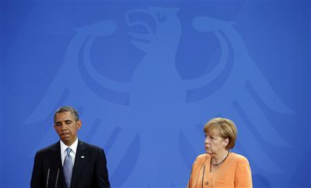 U.S. President Barack Obama and German Chancellor Angela Merkel hold a joint news conference at the Chancellery in Berlin in this June 19, 2013 file photo. REUTERS/Kevin Lamarque/Files