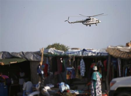A United Nations helicopter flies over the town of Abyei October 25, 2013. REUTERS/Goran Tomasevic