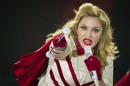 U.S. pop singer Madonna performs during a concert of her MDNA world tour at O2 World in Berlin, June 28, 2012. REUTERS/Thomas Peter