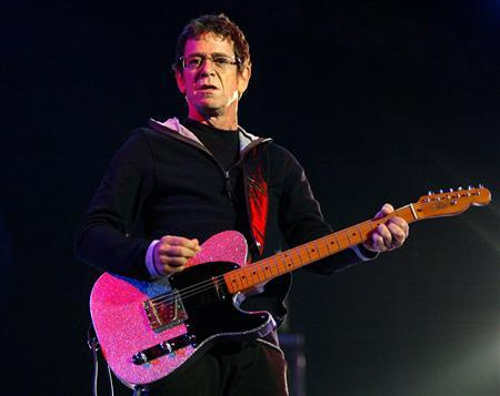 U.S. musician Lou Reed plays the guitar during his concert in Santiago de Compostela in this July 16, 2004 file photograph. REUTERS/Miguel Vidal/Files