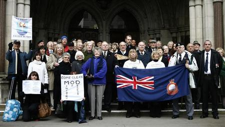 British nuclear test veterans and members of their families stand outside the High Court, in London January 21, 2009. REUTERS/Andrew Winning
