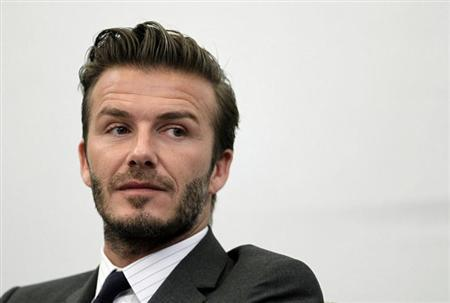 Former England soccer captain David Beckham addresses a news conference in Shanghai June 20, 2013. Beckham arrived in China on Monday to start his second trip as China's soccer envoy. REUTERS/Aly Song