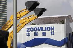 A Zoomlion company logo is seen next to its excavators at an exhibition in Shanghai, in this November 29, 2012 file photo. REUTERS/Stringer/Files