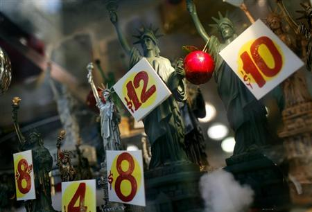 Prices are seen on replica Statues of Liberty figures in a shop window in New York City, November 14, 2011 file photo. REUTERS/Mike Segar