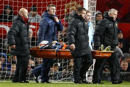 Norwich City's Robert Snodgrass is stretchered off during their English League Cup fourth round soccer match against Manchester United at Old Trafford in Manchester, northern England, October 29, 2013. REUTERS/Darren Staples