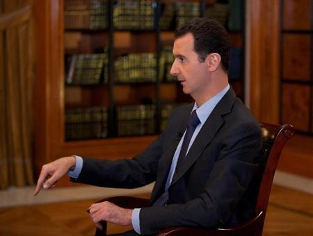 Syria's President Bashar al-Assad speaks during an interview with al-Mayadin television station, in Damascus, in this handout photograph distributed by Syria's national news agency SANA October 21, 2013. REUTERS/SANA/Handout via Reuters