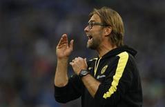Borussia Dortmund's coach Juergen Klopp reacts during the German first division Bundesliga soccer match against Schalke 04 in Gelsenkirchen October 26, 2013. REUTERS/Ina Fassbender