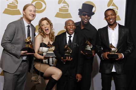 Members of the Tedeschi Trucks Band Derek Trucks, Susan Tedeschi, Saunders Sermons, Kebbi Williams and Maurice Brown ( Lto R) celebrate backstage after winning Best Blues Album (''Revelator'') at the 54th annual Grammy Awards in Los Angeles, California February 12, 2012. REUTERS/Lucy Nicholson