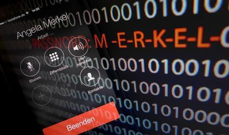 A mobile phone simulating a call to German Chancellor Angela Merkel and computer with a series of numbers is seen in this multiple exposure picture illustration taken in Frankfurt October 28, 2013. REUTERS/Kai Pfaffenbach