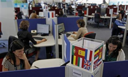 People work at a call center in Lisbon April 22, 2013. REUTERS/Jose Manuel Ribeiro/Files