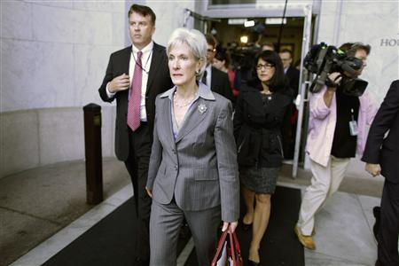 U.S. Health and Human Services (HHS) Secretary Kathleen Sebelius (C) departs after testifying before a House Energy and Commerce Committee hearing about issues and complications with the Affordable Care Act enrolment website, on Capitol Hill in Washington, October 30, 2013. REUTERS-Jonathan Ernst