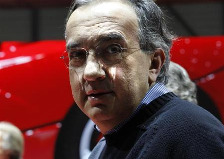 Fiat CEO Sergio Marchionne poses after the presentation of the new LaFerrari hybrid car on the Ferrari stand during the first media day of the 83rd Geneva Car Show at the Palexpo Arena in Geneva March 5, 2013. The Geneva Motor Show will take place from March 7 to 17, 2013. REUTERS/Denis Balibouse