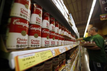 A worker restocks Campbell's soup cans inside a Fresh & Easy store in Burbank, California October 19, 2012. Picture taken October 19, 2012. REUTERS/Mario Anzuoni