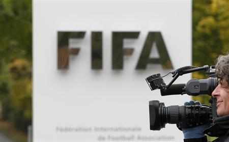 A cameraman films in front of the main entrance of the Home of FIFA in Zurich October 19, 2010. REUTERS/Christian Hartmann