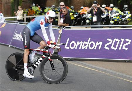 Canada's Ryder Hesjedal competes in the men's cycling individual time trial at the London 2012 Olympic Games August 1, 2012. REUTERS/Mark Blinch