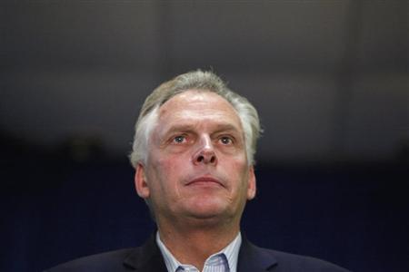 Democratic nominee for Virginia governor Terry McAuliffe stands onstage as former U.S. President Bill Clinton (unseen) campaigns for him at an event in Dale City, Virginia, October 27, 2013. REUTERS/Jonathan Ernst