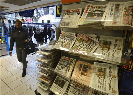 Newspapers are seen on sale at Victoria Station in central London, November 29, 2012. REUTERS/Paul Hackett