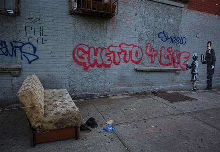 An installation by British graffiti artist Banksy is pictured in the Bronx section of New York October 21, 2013. REUTERS/Eric Thayer