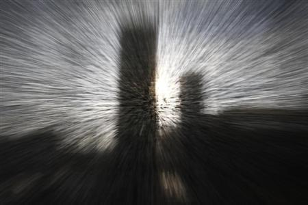 The Marriott Hotel building is photographed through a blind at a restaurant in the centre of Warsaw January 8, 2013. The effect was achieved through zooming action on the lens. REUTERS/Peter Andrews