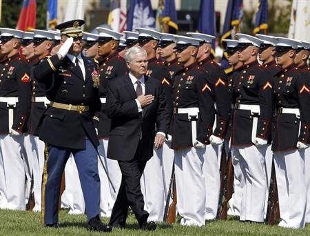 Retiring U.S. Defense Secretary Robert Gates inspects a military honour guard during his farewell ceremony at the Pentagon near Washington, June 30, 2011. Gates will be replaced by former CIA Director Leon Panetta. REUTERS/Jason Reed