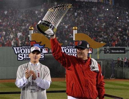 Oct 30, 2013; Boston, MA, USA; Boston Red Sox manager John Farrell hoists the World Series championship trophy after game six of the MLB baseball World Series against the St. Louis Cardinals at Fenway Park. The Red Sox won 6-1 to win the series four games to two. Mandatory Credit: Robert Deutsch-USA TODAY Sports - RTX14UR3