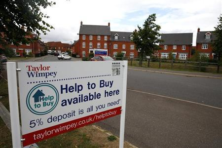 A sign is seen outside newly built houses in Aylesbury, southern England August 13, 2013. REUTERS/Eddie Keogh