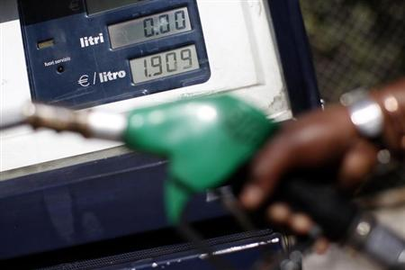 An attendant prepares to refuel a car at a petrol station in downtown Rome March 13, 2012. REUTERS/Tony Gentile/Files
