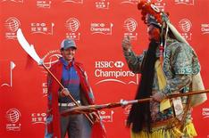 Golfer Rory McIlroy of Northern Ireland attends a photo call for the WGC-HSBC Champions golf tournament on the Bund in Shanghai October 29, 2013. REUTER/Aly Song