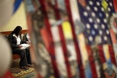 A woman fills out job application forms as she attends a job fair for military veterans and other unemployed people in Los Angeles, California, October 7, 2010. REUTERS/Lucy Nicholson