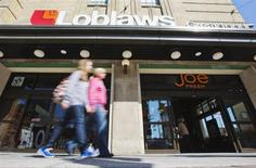 People walk by a Loblaw Companies Limited grocery store with a Joe Fresh clothing store inside, on the day of the annual general meeting of shareholders in Toronto, May 2, 2013. REUTERS/Mark Blinch