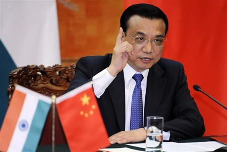 Chinese Premier Li Keqiang speaks during a joint news conference with India's Prime Minister Manmohan Singh at the Great Hall of the People in Beijing October 23, 2013. REUTERS/Kyodo News/Peng Sun/Pool