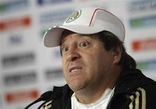 Mexico's national soccer team coach Miguel Herrera listens to a journalist's question during a news conference after a friendly match against Mexico's Altamira soccer team in Mexico City October 26, 2013. REUTERS/Henry Romero