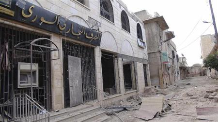A view of a destroyed Syrian Commercial Bank branch after clashes between the Free Syrian Army and forces loyal to Syria's President Bashar al-Assad, at Marat al-Numan, near the northern province of Idlib October 12, 2012. REUTERS/Shaam News Network/Handout