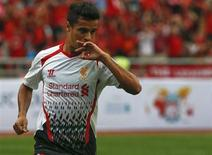 Liverpool's Philippe Coutinho celebrates after scoring against Thailand's national team during their friendly soccer match at Ratchamangkala Stadium in Bangkok, July 28, 2013. REUTERS/Athit Perawongmetha