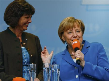 German Chancellor Angela Merkel and Agriculture Minister Ilse Aigner (L) arrive for a Christian Democratic Union election campaign meeting in Miesbach September 11, 2013. REUTERS/Michael Dalder