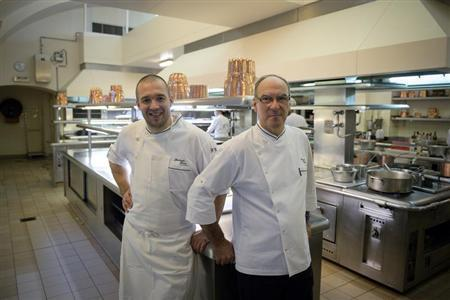 Bernard Vaussion (R), retiring head chef at the Elysee Palace, and his successor Guillaume Gomez (L), pose in the kitchens at the Elysee Palace in Paris, October 31, 2013. REUTERS/Martin Bureau/Pool