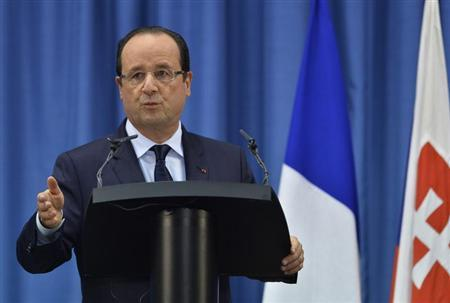 French President Francois Hollande speaks during a news conference at the Slovak government building in Bratislava, October 29, 2013. REUTERS/Radovan Stoklasa
