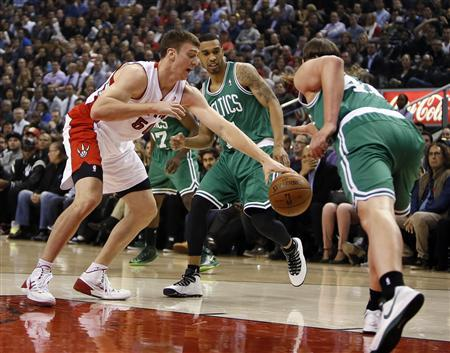 Oct 30, 2013; Toronto, Ontario, CAN; Toronto Raptors forward Tyler Hansbrough (50) tries to take the ball away from Boston Celtics forward Kelly Olynyk (41) as guard Courtney Lee (11) looks on at the Air Canada Centre. Toronto defeated Boston 93-87. REUTERS