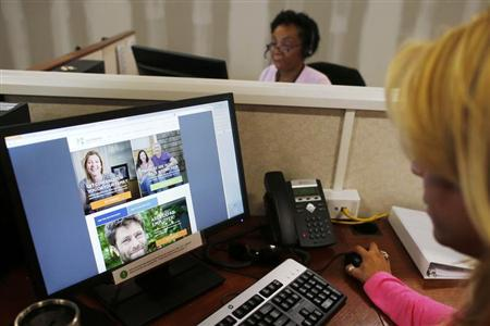 Janet Perez (R) oversees specialists (top) as they help callers and potential customers find health insurance at a customer contact and call center for HealthSource RI, Rhode Island's health insurance exchange program for the Affordable Care Act or ''ObamaCare,'' in Providence, Rhode Island October 25, 2013. REUTERS/Brian Snyder