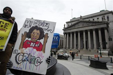 Demonstrators hold signs protesting the New York Police Department's ''stop and frisk'' crime-fighting tactic outside of Manhattan Federal Court in New York, March 18, 2013. REUTERS/Lucas Jackson
