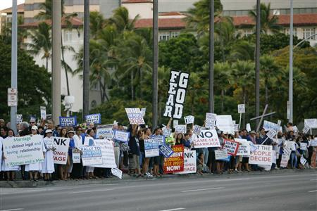 People gather at a rally against same sex marriage at the Hawaii State Capital in Honolulu October 28, 2013. REUTERS/Hugh Gentry