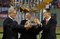 Oct 30, 2013; Boston, MA, USA; Boston Red Sox owners including John Henry (right) and Larry Lucchino (left) and Tom Werner (middle) hold the World Series championship trophy together after game six of the MLB baseball World Series against the St. Louis Cardinals at Fenway Park. Mandatory Credit: Robert Deutsch-USA TODAY Sports