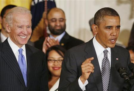U.S. President Barack Obama (R) speaks about immigration reform next to U.S. Vice President Joe Biden in the East Room at the White House in Washington, October 24, 2013. REUTERS/Larry Downing