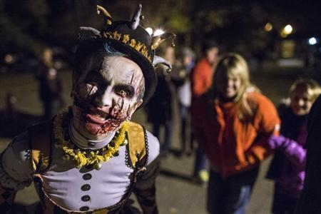 A costumed character entertains ticketed participants before they enter the haunted trail known as the 'Horseman's Hollow' on the grounds of the historic Philipsburg Manor in celebration of Halloween in Sleepy Hollow, New York October 25, 2013. REUTERS/Adrees Latif