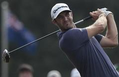 Dustin Johnson of the U.S. tees off on the 10th hole during the second round of the WGC-HSBC Champions golf tournament in Shanghai November 1, 2013. REUTERS/Aly Song