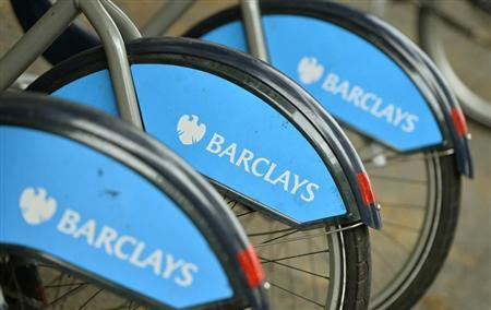 Bicylces for hire, sponsored by Barclays, are lined up in a rack in London October 30, 2013. REUTERS/Toby Melville