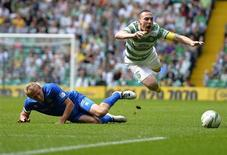 Celtic's Scott Brown (R) is challenged by Inverness Caledonian Thistle's Richie Foran during their Scottish Premier League soccer match at Celtic Park Stadium in Glasgow, Scotland August 24, 2013. REUTERS/Russell Cheyne