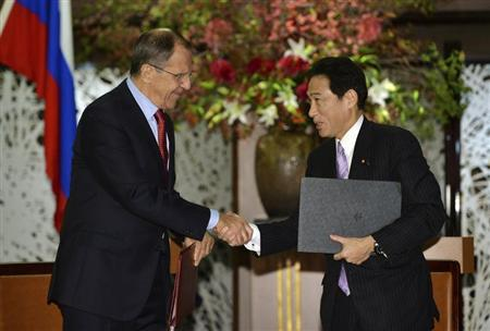Russia's Foreign Minister Sergey Lavrov (L) shakes hands with his Japanese counterpart Fumio Kishida as they exchange documents of their agreement to start high-level consultations after talks at the Iikura guesthouse in Tokyo November 1, 2013. REUTERS/Yoshikazu Tsuno/Pool