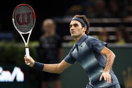 Roger Federer of Switzerland looks at the path of his ball as he faces Juan Martin Del Potro of Argentina in their quarterfinals match at the Paris Masters men's singles tennis tournament at the Palais Omnisports of Bercy in Paris, November 1, 2013. REUTERS/Charles Platiau