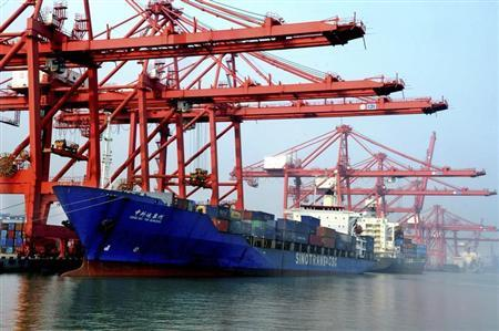 A ship loaded with containers is seen at a port in Lianyungang, Jiangsu province, September 7, 2013. REUTERS/China Daily